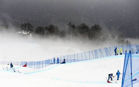 Snow and wind blow on the course before the start of the men's snowboard cross at the Rosa Khutor Extreme Park.