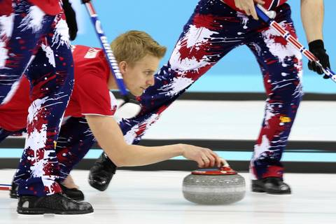 Vad Haavard Petersson, of Norway, delivers a stone during the tie-breaker match between Norway and Great Britain in the curling competition in the Ice Cube Curling Center.
