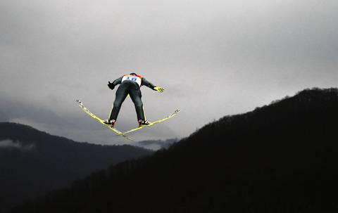 Tomas Portyk, of the Czech Republic, makes a trial jump as he competes in the Nordic combined men's individual LH at RusSki Gorki Jumping Center.