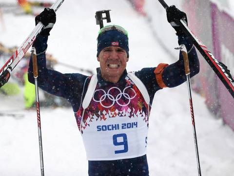 Emil Hegle Svendsen, of Norway, celebrates winning the gold medal during the men's 15K mass start biathlon at the Laura Cross-Country Ski and Biathlon Center.