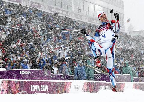 Czech Republic's Ondrej Moravec celebrates after crossing the finish line in the men's biathlon 15k mass start event. Norway's Emil Hegle Svendsen finished first ahead of France's Martin Fourcade and Moravec.