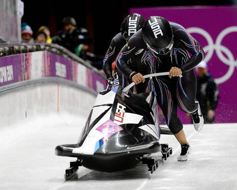 The USA 1 crew of Elana Meyers and Lauryn Williams start their first heat run in the women's bobsleigh at the Sanki Sliding Centre.