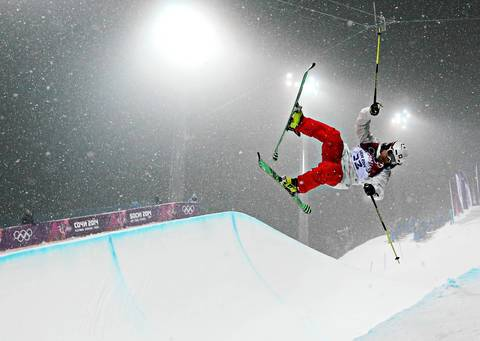Nils Lauper, of Switzerland, competes in a qualifying round for the men's ski halfpipe at Rosa Khutor Extreme Park.