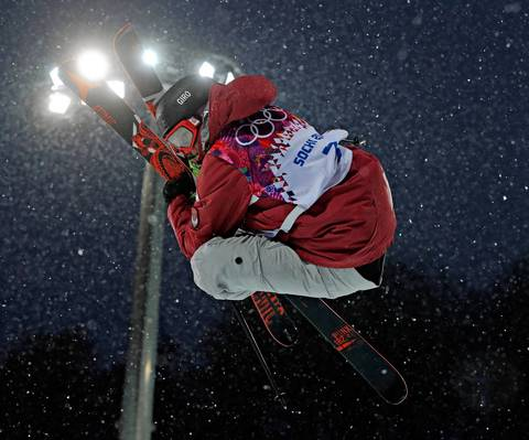 Mike Riddle, of Canada, competes in a qualifying round for the men's ski halfpipe at Rosa Khutor Extreme Park.