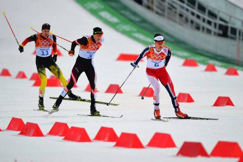 Germany's Bjoern Kircheisen (11), Austria's Bernhard Gruber (3) and gold winner Norway's Joergen Graabak compete in the Nordic combined individual LH / 10 km cross-country event.