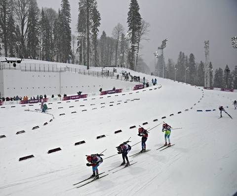 Competitors make their way through the course during the men's 15K mass start biathlon at the Laura Cross-Country Ski and Biathlon Center.
