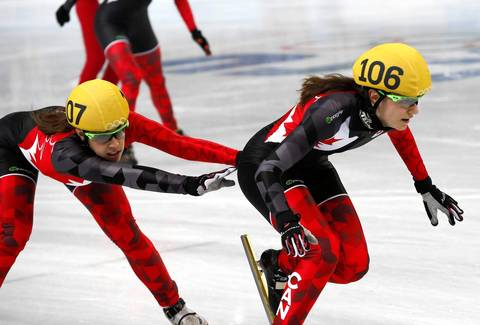 Canada's Valerie Maltais, left, and Jessica Hewitt, right, compete during the women's 3000m relay final of the short track events in the Iceberg Skating Palace.