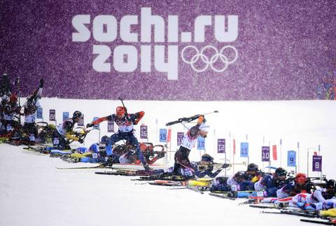 Athletes compete at the shooting range during the men's 15k mass start at Laura Cross-country Ski and Biathlon Center.