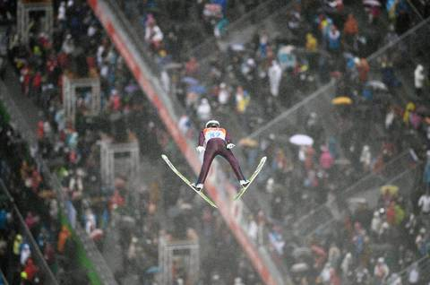 U.S. skier Bryan Fletcher competes in the Nordic combined individual LH / 10km ski jumping competition at the RusSki Gorki Jumping Center.