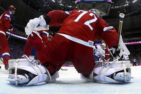Sergei Bobrovski (72), of Russia, tends goal against Norway during the men's ice hockey qualification playoff game.