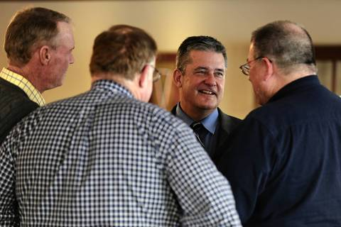 State Treasurer and Republican gubernatorial candidate Dan Rutherford talks with supporters during a meet-and-greet at the Clinton Country Club in Clinton, Ill.