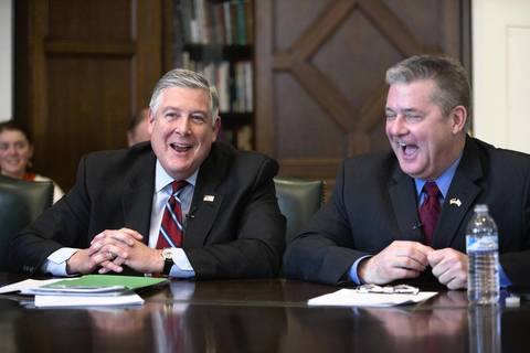 Republican gubernatorial candidates State Sen. Kirk Dillard, left, and State Treasurer Dan Rutherford joke during a meeting with the Chicago Tribune editorial board.