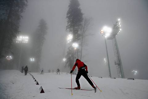"""Made my third attempt to shoot the fog-delayed men's mass start biathlon and it finally took place. It was another strange day for weather with rain everywhere in Sochi, including the mountain village, until you got up to the top of the venues. The biathlon course experienced snow and intermittent fog all morning, delaying the race just a few minutes and creating an interesting and quickly changing backdrop."""