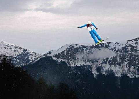 """Several events on the mountain were postponed by the same fog and I worried my men's aerial freestyle skiing event would be too. I made a backup plan to cover the two-man bobsled but headed to the Extreme Park hoping for the best. The fog actually cleared quite a bit and the conditions were perfect."" Anton Kushnir, of Belarus, catches some air as he skis during qualification for men's aerials."