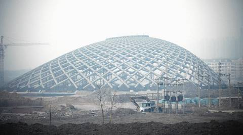 A rail station canopy is under construction at the Binhai New Area development.