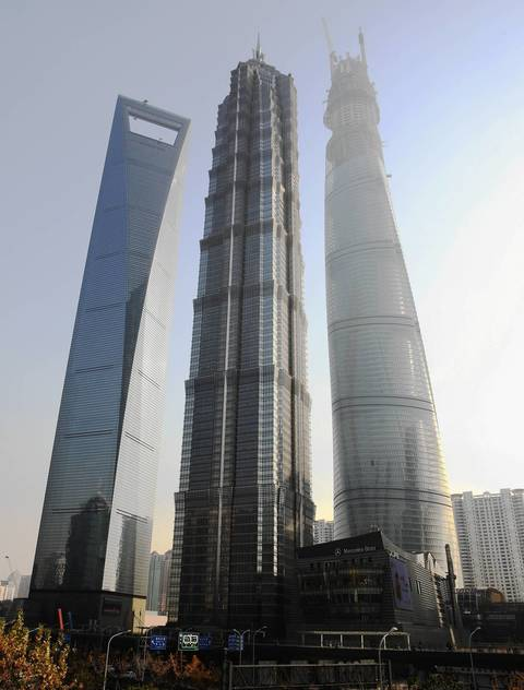The Shanghai World Financial Center, from left, Jin Mao Tower and Shanghai Tower soar above the rest of the Pudong skyline in Shanghai.
