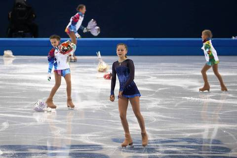 """Yulia's disappointment was evident despite an outpouring of cheers and flowers from the home fans. The 5'2 skater actually didn't look much bigger than the flower girls who were out on the ice collecting bouquets while she reacted."""
