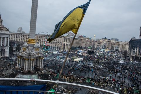 Protester mill about on Independence Square in Kiev, Ukraine.
