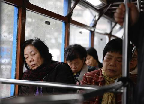 The slow rocking motion of a tram trolley leads passengers to nap in Hong Kong.