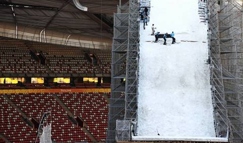 Workers prepare a ski jump ramp inside Beijing National Stadium, also known as the Bird's Nest, in Beijing.