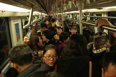 Commuters ride a crowded subway train in Nanjing.