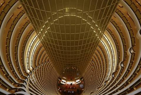 The atrium at the Grand Hyatt Hotel inside the Jin Mao Tower, in Shanghai, is colored in shades of gold.