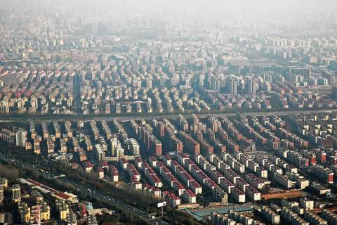 Dozens of housing blocks cluster together in Shanghai. Many of the apartment blocks are filled with middle-class families that enjoy modern conveniences like central heating and private showers, which were unavailable to millions of Chinese as recently as 20 years ago.