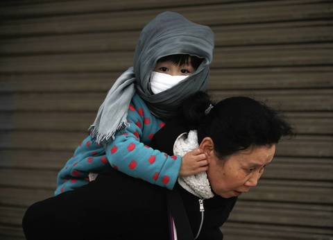 A child wears a face mask in Nanjing.