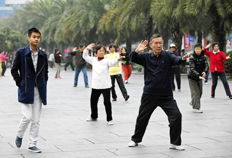 A group practices tai chi in Huacheng Square above the Mall of the World in the Zhujiang New Town area of Guangzhou.