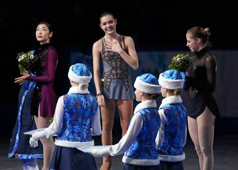 """One thing I've noticed throughout the Games is that the gold and bronze medalists always look the happiest. This was true again tonight as Yuna Kim looked like she knew just close she came to a second gold medal."""