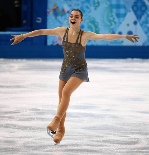 """Russian Adelina Sotnikova skated brilliantly and looked thrilled with her performance, knowing it might be enough for the gold medal."""
