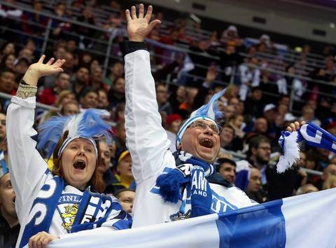 """The ice level position also gives a chance to see the crowd. Many people here may have been hoping to see Russia in this game so the atmosphere wasn't too raucous. After Finland scored a goal though I spotted a pair of particularly inspired fans behind me."""