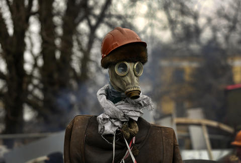 An effigy of an anti-government protester stands at a barricade near Kiev's Independence square.