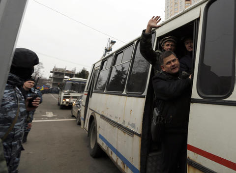 Members of Berkut anti-riot unit leave their barracks in Kiev.