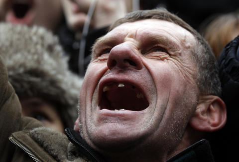An anti-governent protester reacts in the Independence Square Kiev.