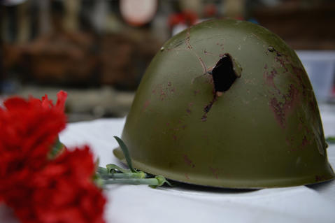 The helmets of an anti-government demonstrator killed in clashes with police is layed on display in Independence Square.