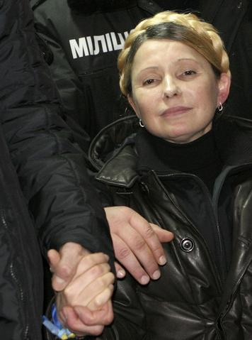 Ukrainian opposition leader Yulia Tymoshenko reacts after she was freed from prison in Kharkiv. The former prime minister, a bitter rival of President Viktor Yanukovich, waved to supporters from a car as she was driven out of the hospital.
