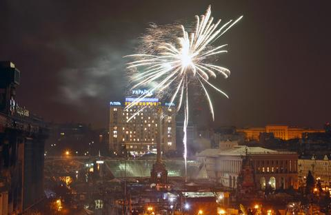 Fireworks explode over the Independence Square after opposition leader Yulia Tymoshenko's speech during a rally in Kiev on Feb. 22.