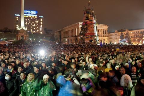 People attend a rally at Independence Square in Kiev on Feb. 22. Newly freed Ukrainian opposition icon Yulia Tymoshenko received a rapturous welcome.