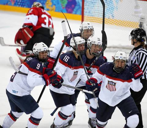 "Team USA celebrates a goal by Hilary Knight (21) against Canada in the second period of a women's hockey game at the Winter Olympics. ""I covered two hockey games today, and the highlight was the USA-Canada women's game. The rivalry is likely a preview of the gold medal game and was tight throughout. The game was scoreless until late in the second period when a U.S. goal gave the team a 1-0 lead and the reaction was great. I was photographing from an upper position to see the whole ice and the American women celebrated nicely in front of Team Canada's goalie."""
