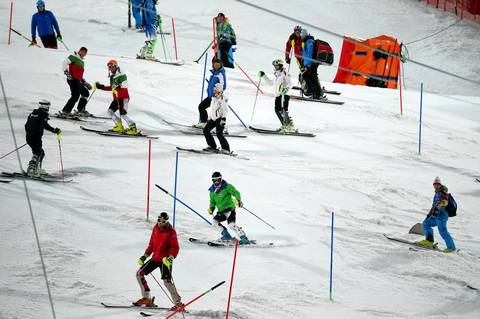 """I took the gondola over to the Alpine Center for an evening slalom race. I liked a moment of the racers inspecting the course before their second run when they came down en masse, trying to memorize the gate positions."""