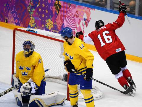 Canada forward Jonathan Toews (16) celebrates his goal against Sweden goalie Henrik Lundqvist (30) in the first period of the gold medal men's hockey game at the Winter Olympics in Sochi, Russia.