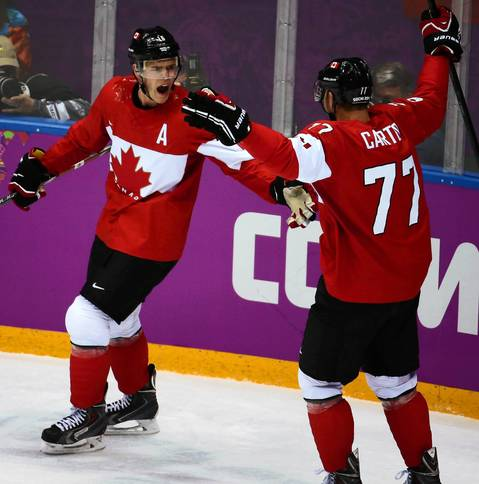 Canada forward Jonathan Toews (16) celebrates his goal with Jeff Carter (77) against Sweden in the first period of the gold medal men's hockey game at the Winter Olympics in Sochi, Russia.