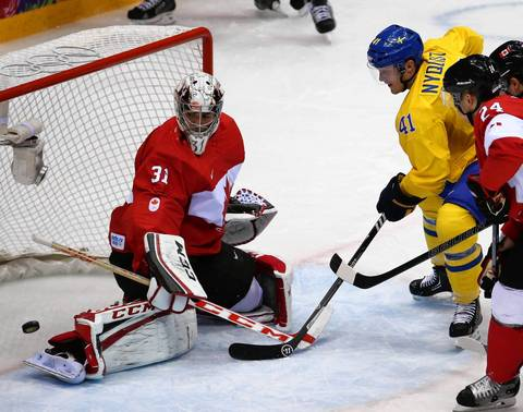 Sweden forward Gustav Nyquist (41) can't score against Canada goalie Carey Price (31) in the first period of the gold medal men's hockey game at the Winter Olympics in Sochi, Russia.