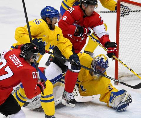 Sweden goalie Henrik Lundqvist (30) makes a save against Canada in the first period of the gold medal men's hockey game at the Winter Olympics in Sochi, Russia.