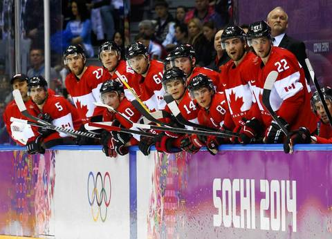 Canada's players watch the closing seconds of their men's ice hockey gold medal game against Sweden at the Sochi 2014 Winter Olympic Games.