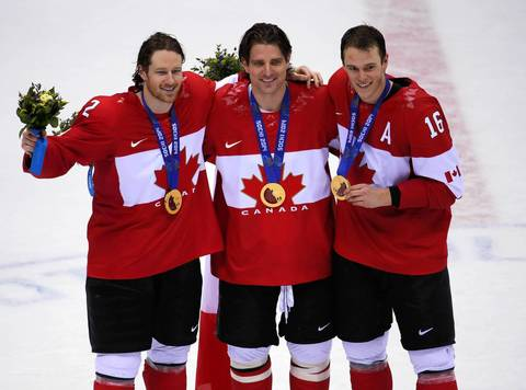 Canada's Duncan Keith, Patrick Sharp and Jonathan Toews, also teammates on the NHL's Chicago Blackhawks, celebrate their win in the gold medal men's hockey game at the Winter Olympics in Sochi, Russia. Canada defeated Sweden, 3-0.
