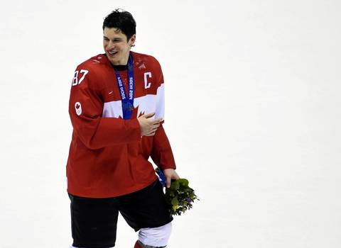 Canada forward Sidney Crosby (87) skates off the ice with his gold medal after defeating Sweden in the men's ice hockey gold medal game during the Sochi 2014 Olympic Winter Games at Bolshoy Ice Dome.