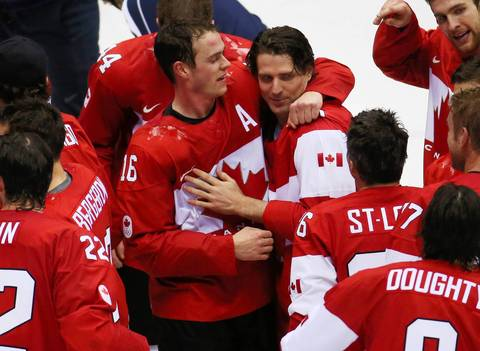 Canada forward Jonathan Toews (16) celebrates with Patrick Sharp after the gold medal men's hockey game at the Winter Olympics in Sochi, Russia. Canada defeated Sweden, 3-0.