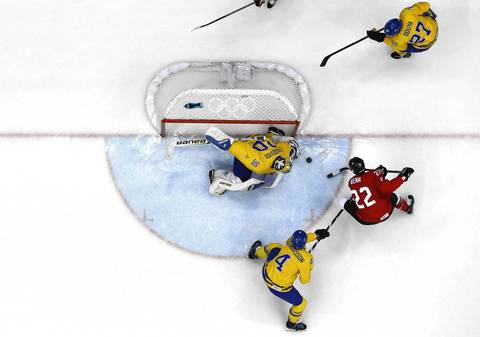Henrik Lundqvist #30 of Sweden makes a save from Jamie Benn #22 of Canada during the Men's Ice Hockey Gold Medal match on Day 16 of the 2014 Sochi Winter Olympics at Bolshoy Ice Dome.
